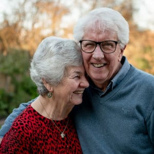 A smiling senior couple.