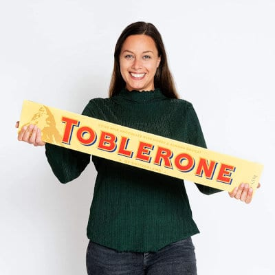 A person holding the Toblerone Jumbo chocolate bar.