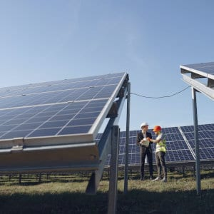 Workers inspecting a solar panel system.