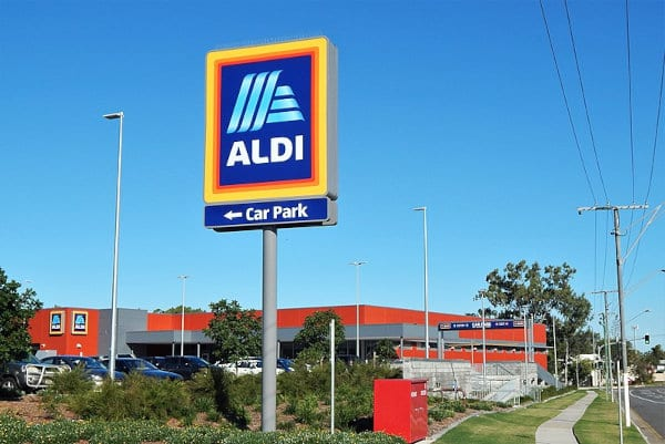 An Aldi road sign by an Aldi store.