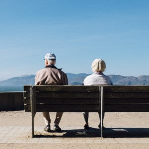 A senior couple admiring the view outdoors.