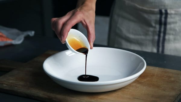 Vinegar being poured onto a plate.