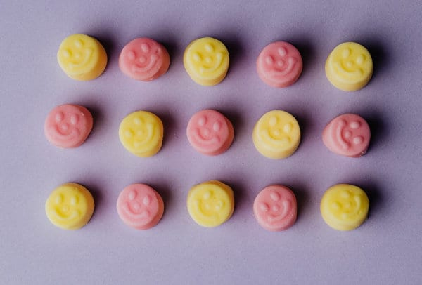 Gummies with smiley faces on them.