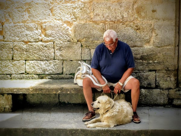 A senior man with his dog.