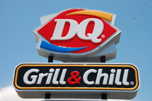 A road sign of a Dairy Queen location.
