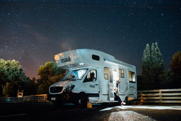 A parked RV at nighttime.