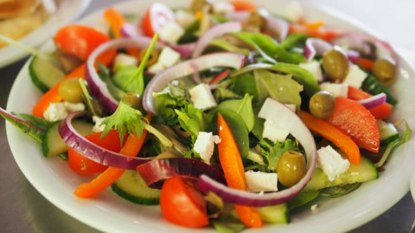 A delicious-looking serving of salad.