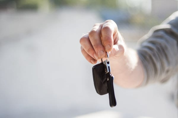 A person holding car keys.
