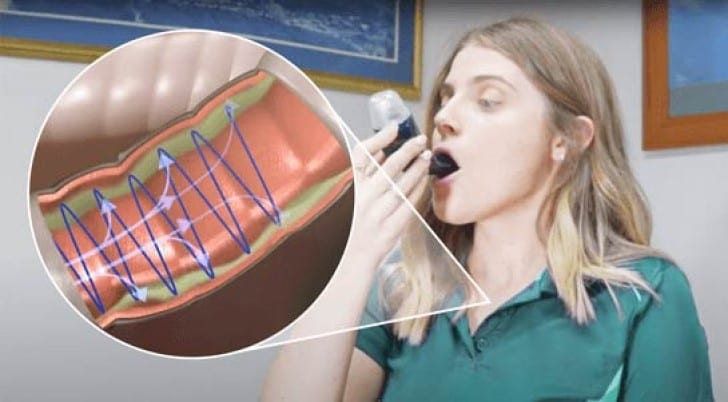 A person using the AirPhysio mucus clearing device.