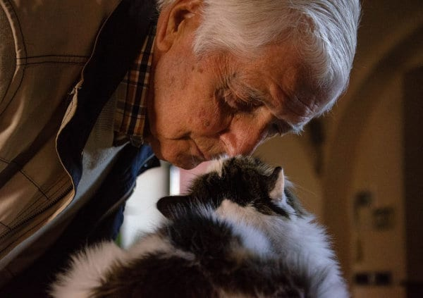 A senior person and a cat.