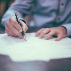 A person signing documents.